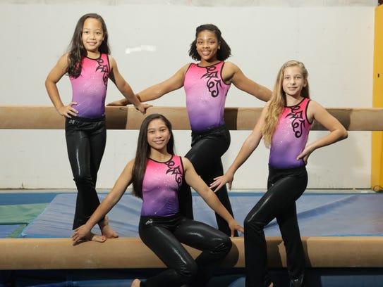 Four gymnasts from Island Twisters Gymnastics are headed
