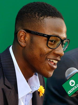 Boston Celtics draft pick Terry Rozier smiles while talking to the media after his introduction at the Celtics basketball training facility, Tuesday in Waltham, Mass.