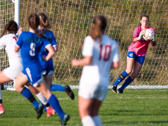 Colchester's Gabby Gosselin, right, saves a shot by