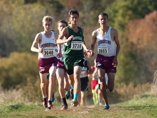 Montville's Jenks Hehmeyer, c,  sandwiched in between Morristown's Evan Quinn, l, Ben Edwards and Eric Clay in the Northwest Jersey Athletic Conference varsity large school boys cross country championships at Greystone Park. October 20, 2015, Morris Plains, NJ