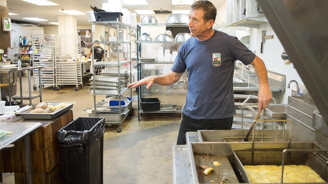 Joe Scully, owner of Chestnut, makes potato chips while talking with an employee Thursday May 18, 2017 in the catering kitchen of Chestnut, a restaurant located in Biltmore Avenue.