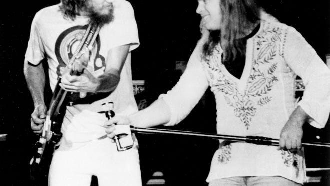 SPECIAL TO THE CLARION LEDGER--FILE-- Lynyrd Skynyrd Lead singer Ronnie Van Zant (right) urges on guitarist Steve Gaines during a performance at Convention Hall in Asbury Park, New Jersey July 20, 1977. AP Photo/str)