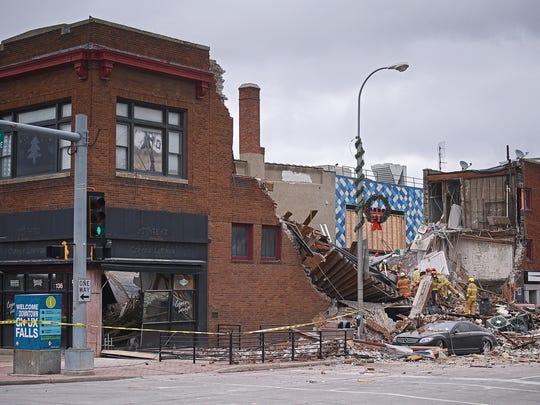 Emergency personnel on scene after the Copper Lounge building collapse Friday, Dec. 2, 2016, in downtown Sioux Falls.