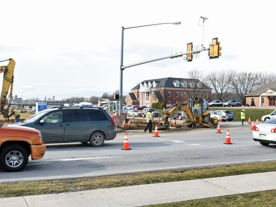 Orange cones keep vehicles moving safely away from construction at the intersection of Norland and Fifth avenues, on Thursday, January 19, 2017. Part of the North Chambersburg Improvements Project, work was being done to widen the intersection.