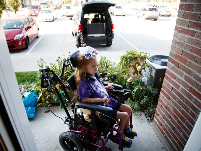 Alannah Calby, 6, waits for her mother, Lindsey Calby,