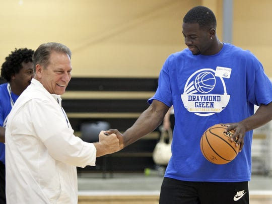 Michigan State coach Tom Izzo, left, greets Draymond Green during Green's basketball camp at MVP Fieldhouse in Grand Rapids on June 25, 2014.