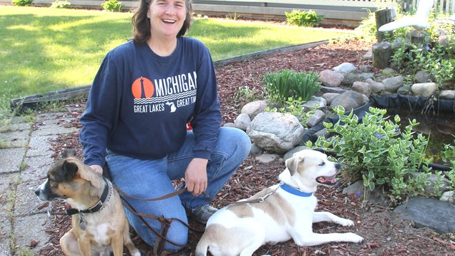 Laura Johns, Obedient K-9 4-H Club leader, with two of her rescues, Brownie and Lucky.