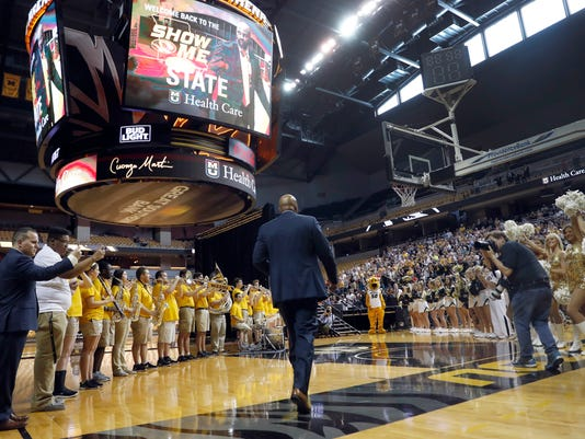 Cuonzo Martin walks past a pep band and cheerleaders to be formally introduced to fans as the new men's basketball coach at Missouri, Monday, March 20, 2017, in Columbia, Mo. Martin spent the past three seasons as coach at California and comes to Missouri with hopes he can revive the struggling program. (AP Photo/Jeff Roberson)