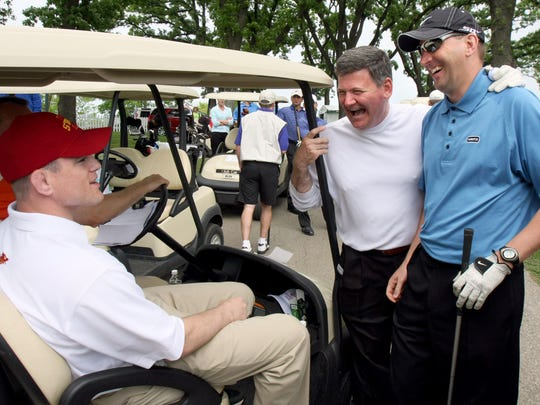 Athletics Director Jamie Pollard, right, with Ray Cole, jokes with Cael Sanderson, left, at the Principal Charity Classic pro-am in 2008 at Glen Oaks Country Club in West Des Moines.