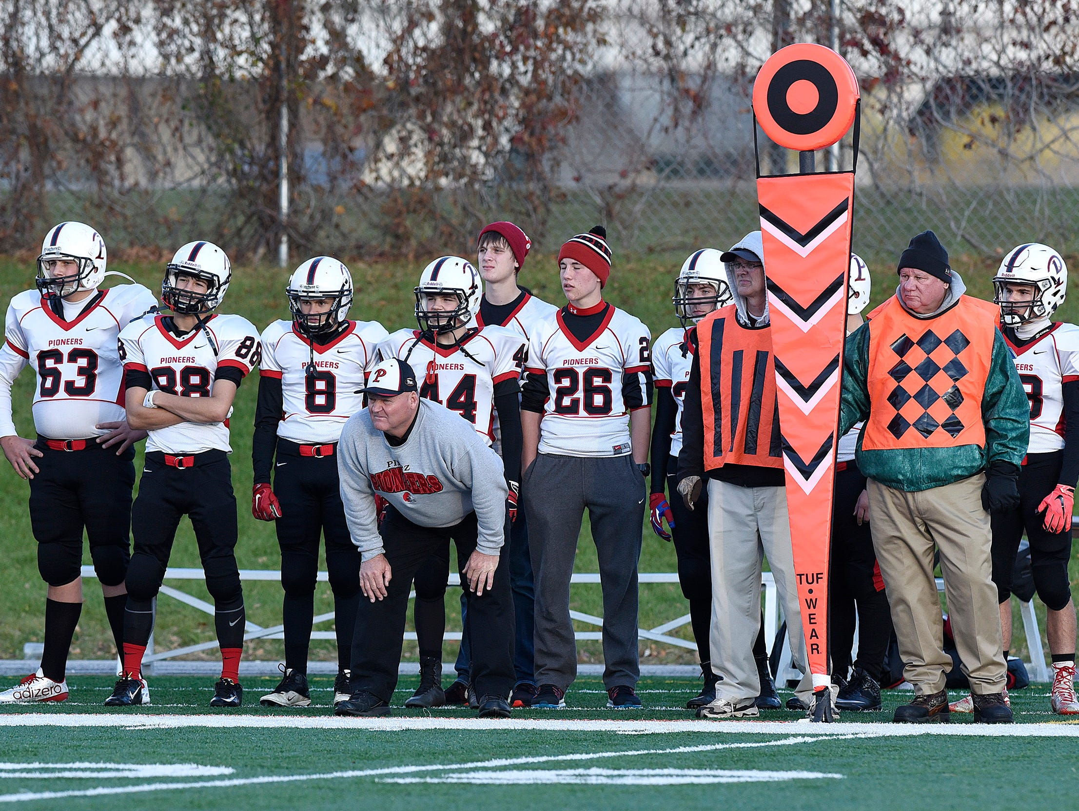 Pierz coaches and players watch the action during a game at Husky Stadium in St. Cloud. The Pioneers are playing in the Class 3A state semifinals for the second straight season.