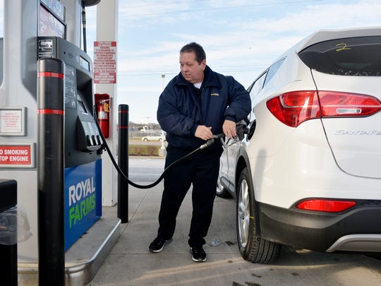Ron Marra of Taneytown, Md., pays for gas on Wednesday.