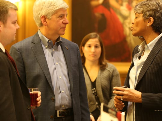 Governor Rick Snyder, center, speaks with Faye Nelson as he greets people at the Michigan Chronicle's  2016 Pancakes & Politics at the Detroit Athletic Club Monday, April 11, 2016, where he is the key note speaker.