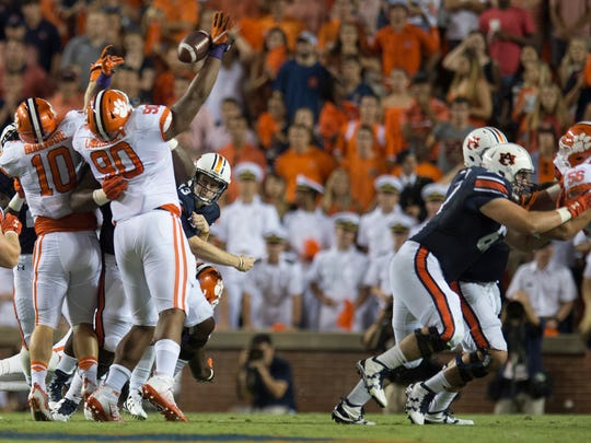 Clemson defensive tackle Dexter Lawrence (90) deflects a pass from Auburn quarterback Sean White (13) during a game at Jordan-Hare Stadium on Saturday, Sept. 3, 2016, in Auburn, Ala.