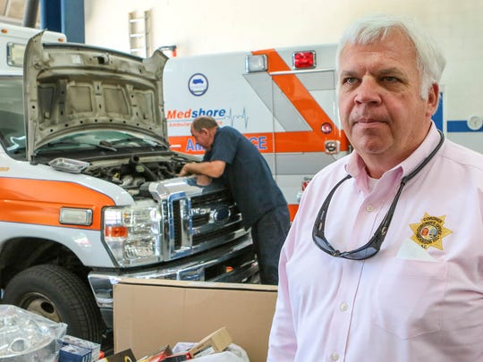Greg Shore, chief executive officer of Medshore Ambulance in Anderson talks about repairs being one of the companies expenses partly from bad roads in the area, while mechanic Smoke Shiflett works on one Wednesday. South Carolina's legislature is considering bills that would raise the cost of fuel by at least 10 cents over the next five years. Vehicle registration fees will rise in both the S.C. House and Senate bills, plus raise fees on drivers' licenses.