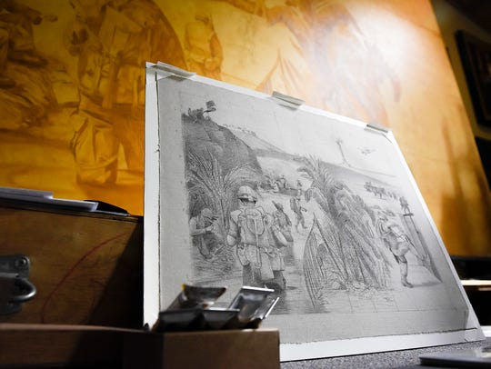 Artist Charles Kapsner works from a detailed drawing