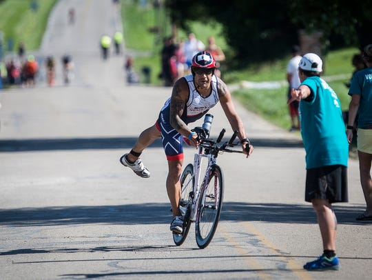 Michael Mendoza transitions from the 56 mile bike ride