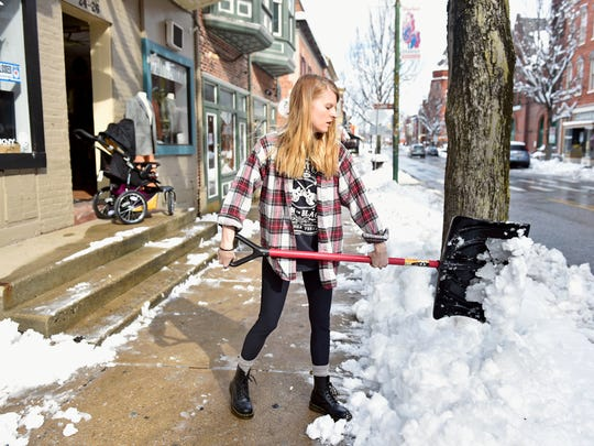 Jessica Weikert shovels snow the day after a nor'easter