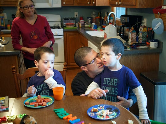5-year-old twins Ryan and Matthew Logsdon eat dinner with their parents Mark and Angela Wednesday, March 15, 2017. The boys are both Autistic and the family is planning to attend sensory-friendly theater performance designed with special needs in mind.