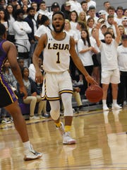 LSUA guard Brandon Ellis (1) brings the ball up the