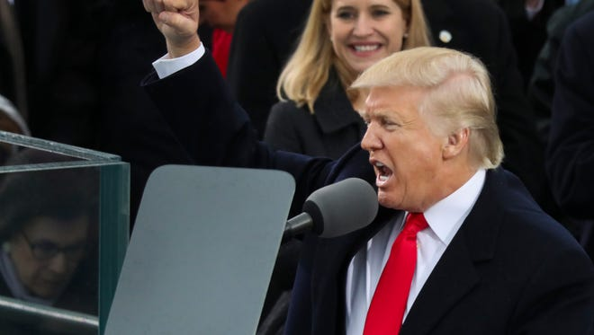 "President Donald Trump pumps his first at the end of his speech after bring sworn in as the 45th president of the United States during the 58th Presidential Inauguration at the U.S. Capitol in Washington, Friday, Jan. 20, 2017. In the speech, Trump called for a significant departure in foreign policy, calling for an ""America First"" approach. (AP Photo/Andrew Harnik)"