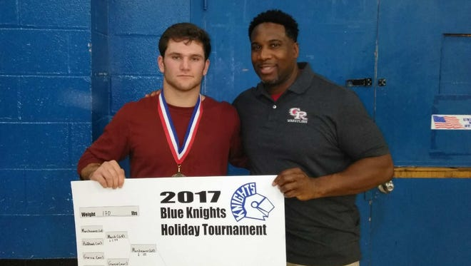 Glen Ridge wrestling coach Kendall Southerland (right) and Joe Marchesano, who took first place at the Blue Knight Tournament.