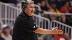 West Virginia Mountaineers head coach Bob Huggins reacts