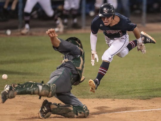 La Quinta's Trenton Schwanke dives for home to give La Quinta a two point lead against Monrovia in the 5th inning during the CIF SS Div 4 Championship game on Saturday, June 2, 2018 at UC Riverside.