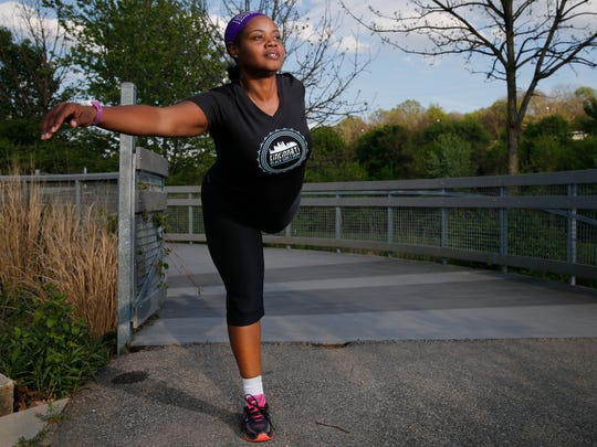 Tamiko Wiley, 39, stretches, Monday, April 25, 2016, at Salway Park in Cincinnati. SheÕs preparing for a Flying Pig relay and her first half-marathon in Canada in June.
