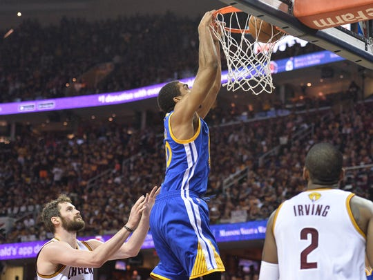 Jun 10, 2016; Cleveland, OH, USA; Golden State Warriors forward James Michael McAdoo (20) dunks the ball in front of Cleveland Cavaliers forward Kevin Love (0) and guard Kyrie Irving (2) during the first quarter in game four of the NBA Finals at Quicken Loans Arena. Mandatory Credit: Ken Blaze-USA TODAY Sports