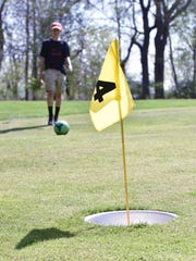 Zack Ymbras, 15, of LaGrange, demonstrates footgolf