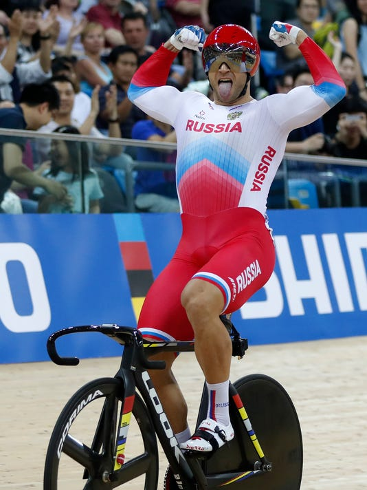 Russia's Denis Dmitriev celebrates after winning the men's sprint final at the World Track Cycling championships in Hong Kong, Saturday, April 15, 2017. (AP Photo/Kin Cheung)