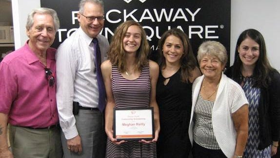 Meghan Reilly (center), of Boonton, recently accepted a Simon Youth Foundation Community Scholarship valued at $1,500. Rockaway Townsquare Mall Manager Paul Crociata (second from left) and Area Director of Marketing and Business Development Maria Gregorius (right) presented her with a certificate in recognition of her achievement during a ceremony held at the property.