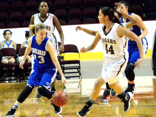 Carlsbad junior guard Lauryn Wade comes up with a steal in the first quarter Thursday.