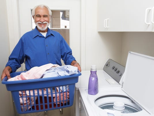 Senior doing laundry