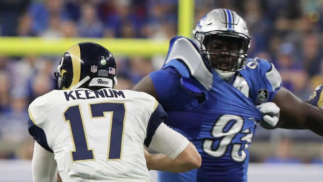 Lions defensive tackle Tyrunn Walker rushes Rams quarterback Case Keenum during the first half Sunday, Oct. 16, 2016 at Ford Field.