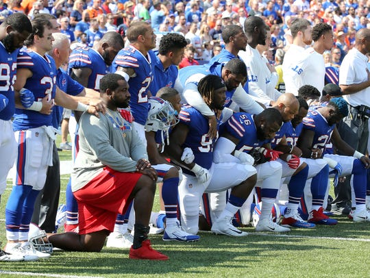 Players from both teams took a knee during the national