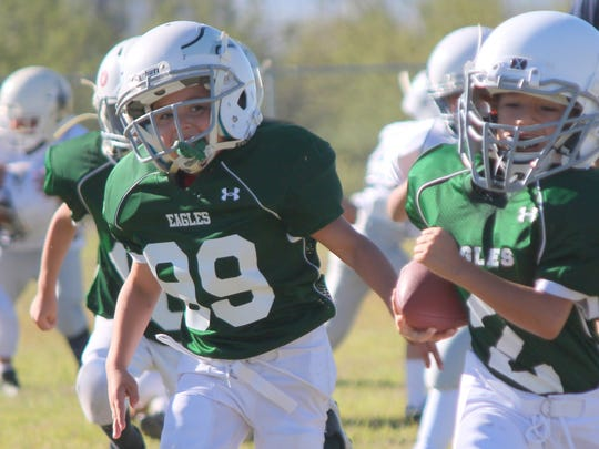 Eagles player Angel Bencomo (2) sprints toward the endzone for a touchdown during Saturday's Luna County Youth Football League's game. Games start at 8 a.m. at the Shirley Sayre Memorial fields on Raymond Reed Blvd.