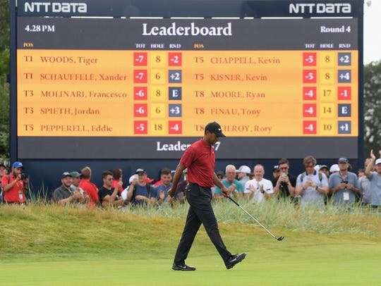 Tiger Woods tops the British Open leaderboard while