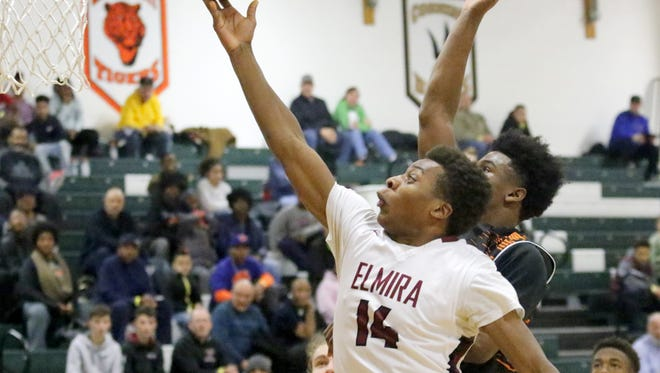 Daryl Savage of Elmira goes up for a shot as Curtis Jacobs of McDonogh tries for the block Saturday during the Eagles' 53-51 win in the National Division third-place game at the Josh Palmer Fund Elmira Holiday Inn Classic at Elmira High School.