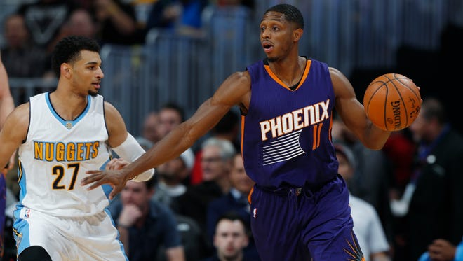 Phoenix Suns guard Brandon Knight (11) looks to pass the ball as Denver Nuggets guard Jamal Murray defends in the first half of an NBA basketball game, Wednesday, Nov. 16, 2016, in Denver.