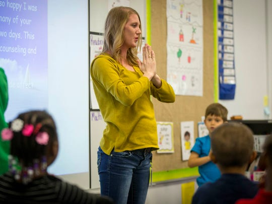 Teacher Alisha Sinclair leads her kindergarten class at Edmunds Academy in Des Moines in practicing yoga at the beginning of the school day, Oct. 13, 2016.