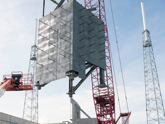 On Sept. 15, a crane lifted the first tier for placement