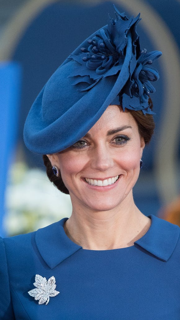 A close-up of Kate's Locke & Co. hat and the Queen's Maple Leaf Brooch in diamonds.