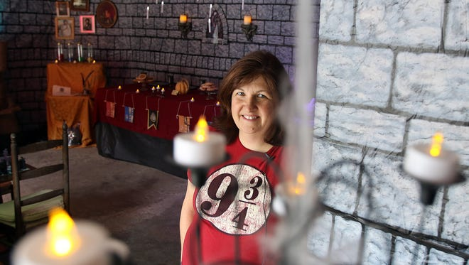 Dody Marriott decorates her garage at her home on Capitol Drive in Hartland to look like Hogwarts from the world of Harry Potter. Marriott encourages kids on Halloween to make their way through her display and enjoy what she has constructed.