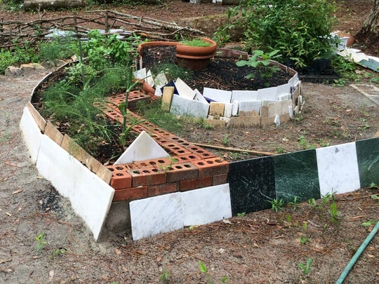 Although wood is most popular, you can use materials such as concrete, bricks, or tiles to build a raised bed.