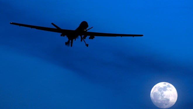 An unmanned U.S. Predator drone flies over Kandahar Air Field in southern Afghanistan on Jan. 31, 2010.