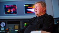"""William Shatner, who portrayed Capt. James T. Kirk in """"Star Trek,"""" returns to his familiar chair at a remake of show's set."""
