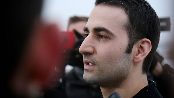 Former U.S. Marine Amir Hekmati, 32, talks to the media after arriving to Bishop International Airport on Thursday, Jan. 21, 2016, in Flint.