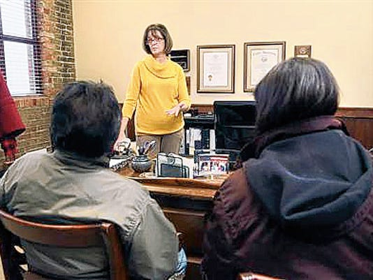 Immigration attorney Susan Nelson talks to her clients Gilbert and Gabriela, who hope to get deferred status under the president's immigration executive action. A federal judge has put a hold on the program.