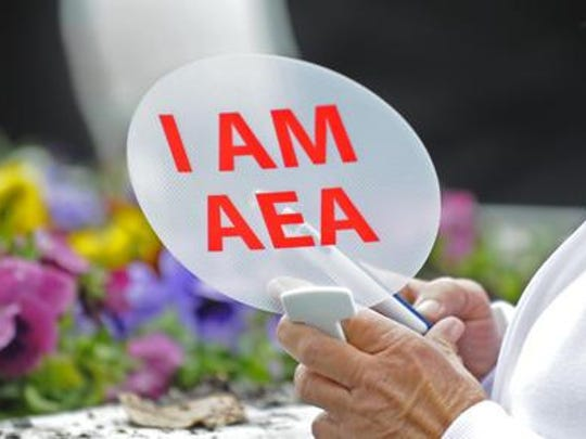 An Alabama Education Association member holds up a fan during an AEA rally at the State House in 2014.